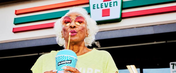 Woman Blowing Out Slurpee Candle